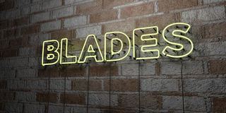BLADES - Glowing Neon Sign on stonework wall - 3D rendered royalty free stock illustration Royalty Free Stock Photos