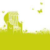 Blades of grass and beach chair. In the sun Stock Images