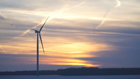 The blades of the wind turbine rotate slowly stock footage