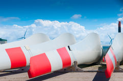 Blades of a windmill on the ground. Storage of big wind mill blades Royalty Free Stock Photos