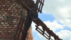 The blades of the windmill spinning close-up stock video footage