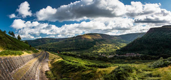Blaenrhondda from the Rhigos. The highest mountain in the Rhondda valleys, Pen Pych towers above the village of Blaenrhondda at the top of the valley of the Royalty Free Stock Images