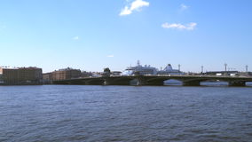 The Blagoveshchensky Bridge in St. Petersburg. Kruizny liner is visible beyond the bridge stock footage