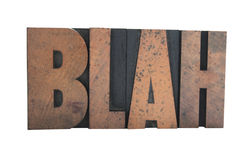 'blah' in old wood type. Old, inkstained wood letterpress type spells out the word 'blah' in all caps Stock Photos