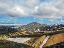 Blahnukur mountain and rhyolite mountains covered with snow in Landmannalaugar geothermal region, South Iceland stock image