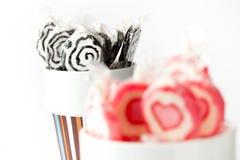 Blak e lollipops cor-de-rosa Imagem de Stock