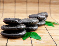 Blak spa stones with leaf and water Stock Photo