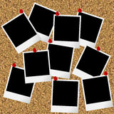 Blakn photo frames hanging on cork board with pushpins Stock Photos