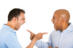 Blame and accusation. Closeup portrait of two guys angry pointing fingers at each other and blaming for problems, isolated on white background Stock Photos