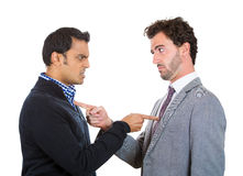 Blame. Closeup portrait, two angry men pointing fingers at each other blaming for problems, isolated white background. Interpersonal conflict. Negative human Royalty Free Stock Photo