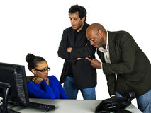 Blame the girl. Two male office workers blaming and angry at the only female office worker royalty free stock photo