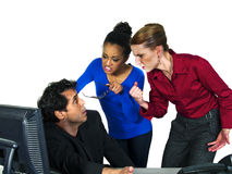 Blame the guy. Two female office workers blaming and angry at the only male office worker royalty free stock photo