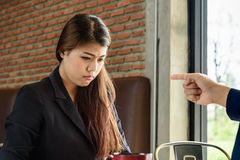 Blaming frustrated businesswoman in office, selective focus Royalty Free Stock Photo