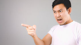 He is blaming someone. An asian man with white t-shirt and grey background stock images