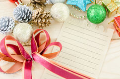 Blan brown paper for your text with red ribbon and christmas dec Stock Photos