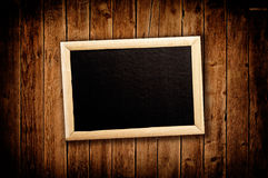 Blan message board on wooden background Stock Photo