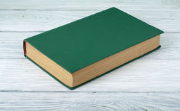 Blanc book cover on textured wooden background. Green book on wooden table.Education background.Back to school Stock Photography