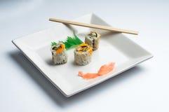 blanc d'isolement de sushi de grand dos de plaque Photos stock