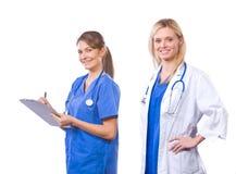 blanc d'isolement par femelle d'équipe médicale image stock