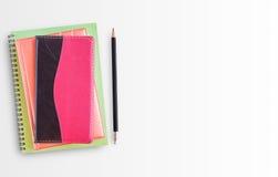blanc de crayon de cahier de fond Photos stock