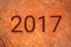 Blanc de la nouvelle année 2017 sur le métal rustique Photos stock