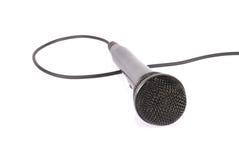 blanc de microphone d'isolement par fond Photographie stock