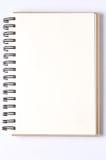 blanc de spirale de papier de cahier d'isolement par blanc de fond carnets de notes à spirale de papier d'isolement Photo stock
