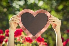 Blanc de tableau noir de forme de coeur Photographie stock