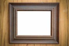 Blanc en bois de cadre de tableau sur le fond en bois Photo libre de droits