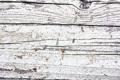 Blanc et conseil en bois criqué et épluchant grisâtre peint de mur comme fond de texture Photos stock