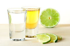 Blanc and Gold Tequila with lime slices Royalty Free Stock Photo
