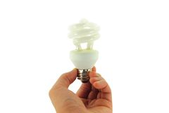 blanc léger d'isolement par main d'ampoule Photographie stock