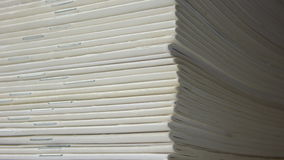 Blanc Magazines. Row of equal used newspapers Stock Photo