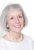 Blanc s'usant de sourire de femme aîné Photographie stock libre de droits