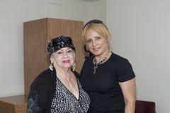 Blanca Iris Villafane and Mayra Roman. BRONX, NY - June 24:  veteran Bolero singer Blanca Iris Villafane and radio speaker Mayra Roman in a waiting area during Royalty Free Stock Images