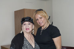 Blanca Iris Villafane and Mayra Roman. BRONX, NY - June 24:  veteran Bolero singer Blanca Iris Villafane and radio speaker Mayra Roman in a waiting area during Royalty Free Stock Image