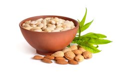 Blanched almonds In a bowl with unshelled nuts. On white backgro. Und Royalty Free Stock Image