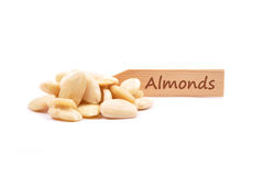 Blanched almonds at plate Stock Photography