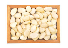 Blanched almonds at plate Royalty Free Stock Image