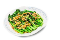 Blanched Chinese Choy Sum vegetable with garlic oil dish.  royalty free stock image