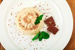 Blancmange with chocolate on glass plate. Closeup shot stock photo