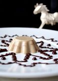 Blancmange with chocolate sauce on white plate. Coffee blancmange with chocolate sauce on white plate stock images