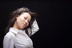 Blanco asiático de la belleza en negro Imagen de archivo