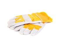 Blanco del amarillo de los guantes de la construcción Foto de archivo libre de regalías