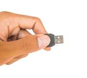 Blanco del usb del uso de la mano aislado Imágenes de archivo libres de regalías