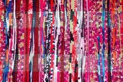 Blanco púrpura del negro del rojo azul de la tela del rosa colorido del fondo Fotos de archivo libres de regalías