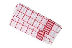Blanco rojo de la toalla de cocina aislado según lo cortado Foto de archivo libre de regalías