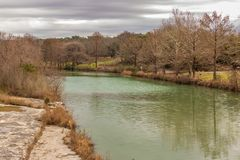 Blanco State Park 1. A view downstream along the Blanco River in Blanco State Park in Blanco, Texas. The river has a green color to it as it flows through the royalty free stock photo