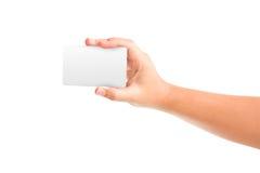Blancs de carte dans une main Photographie stock