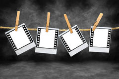 Blancs polaroïd de film avec des cadres de 35mm Photographie stock
